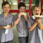 Students from Haileybury eating pancakes