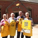 Volunteers from Kyneton Uniting Church pose for a photo on Pancake Day 2015