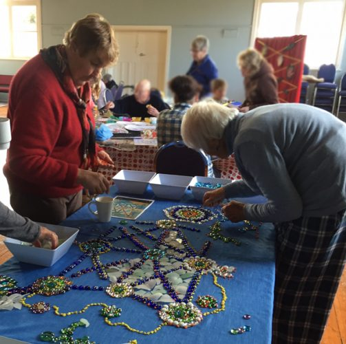 Libby Norwood and Mary Grace Whyte work on the mandala