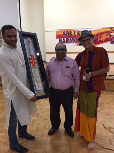A cricket bat signed by the Sri Lankan team who were victorious against Australia this year was auctioned and raised $550 for the work to continue.