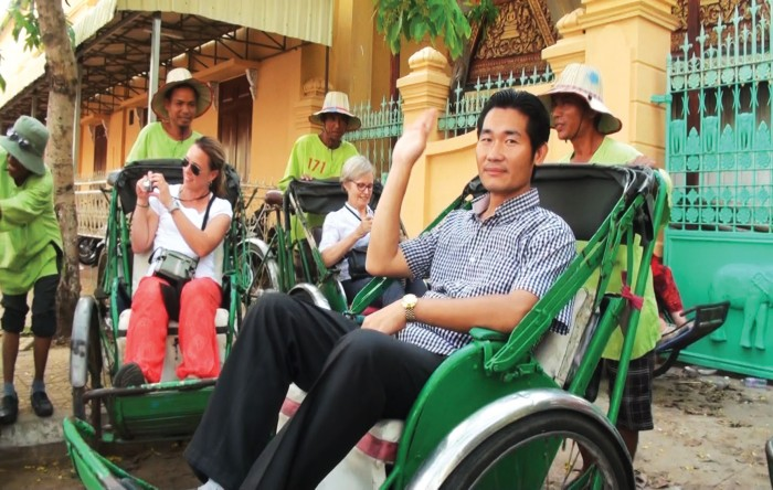 Cambodian tour guide in cyclo