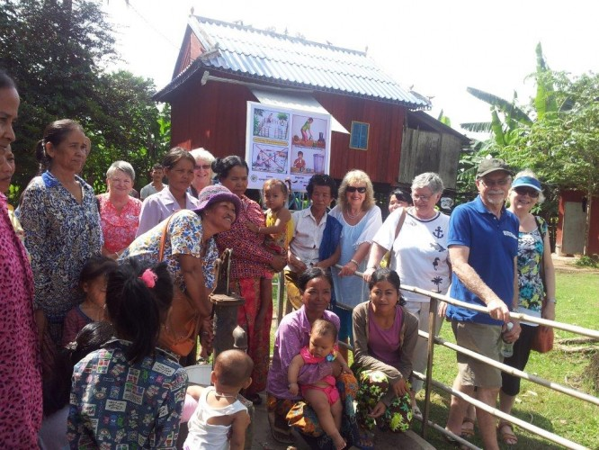 Participants around a shared well in the Chuuk District of Kampot Province in Cambodia during a visit to the Cambodian Organisation for Children and Development, a local NGO which helps some of the area's poorest people.