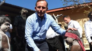 Tony Abbott patting child on head