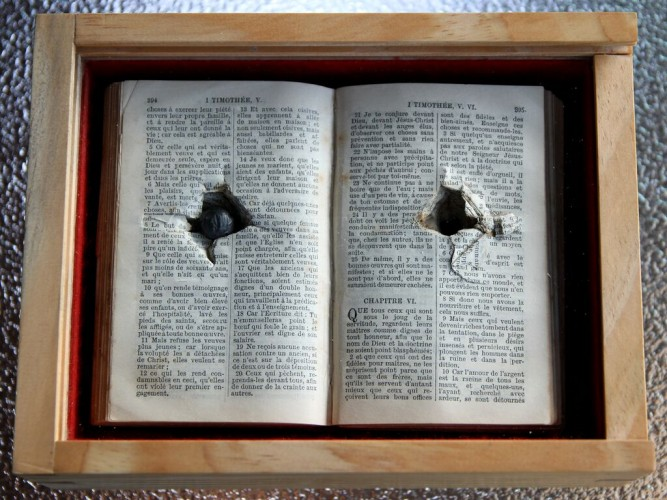 image of a shrapnel in a bible
