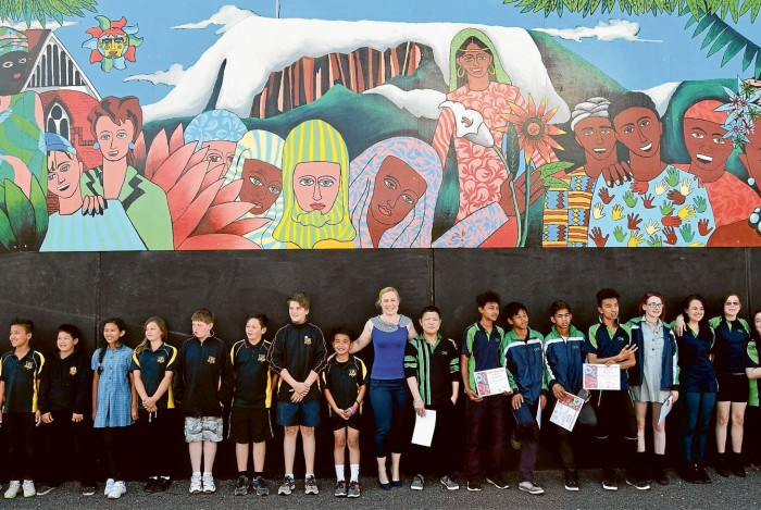 Glenorchy Mayor Alderman Kristie Johnston opening the mural with the students from Glenorchy Primary and Cosgrove High Schools, who painted the mural.
