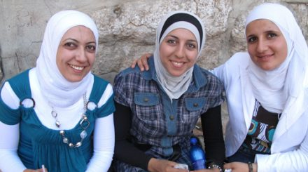women outside music shop in Syria