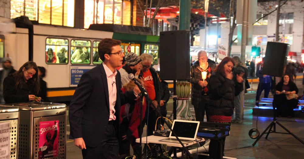 Daniel Webb speaking at the refugee vigil in Melbourne