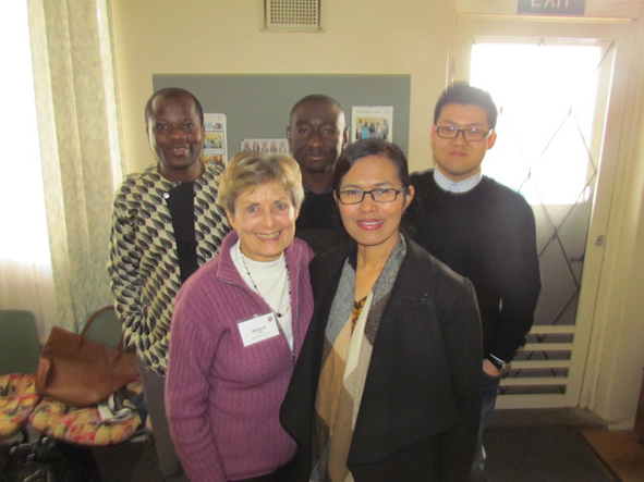 Noah (top right) with Margaret Farrell (bottow left) and members of the Monash UCA congregation.jpg