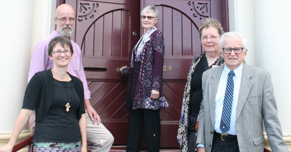 South Esk Cluster Chair Hilary Parry closes the door at Trinity Uniting for the last time flanked by (clockwise from left) Rev Michelle Cook, Craig Osborne, Mary Rothwell and Clarrie Pryor.