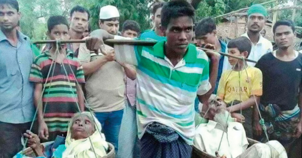 rohingya man carries his parents
