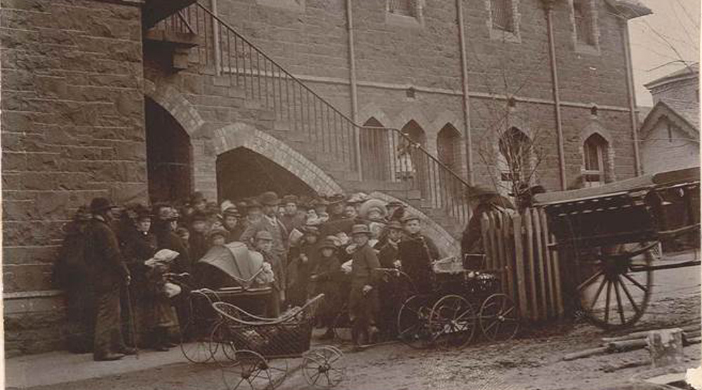Local residents queueing for relief in the Wesley Church yard.
