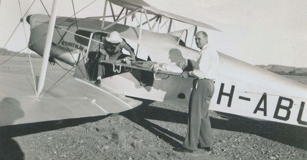 This 1946 photo shows Rev Cliff Lanham with an ex-RAAF biplane purchased by the Methodist Inland Mission Board