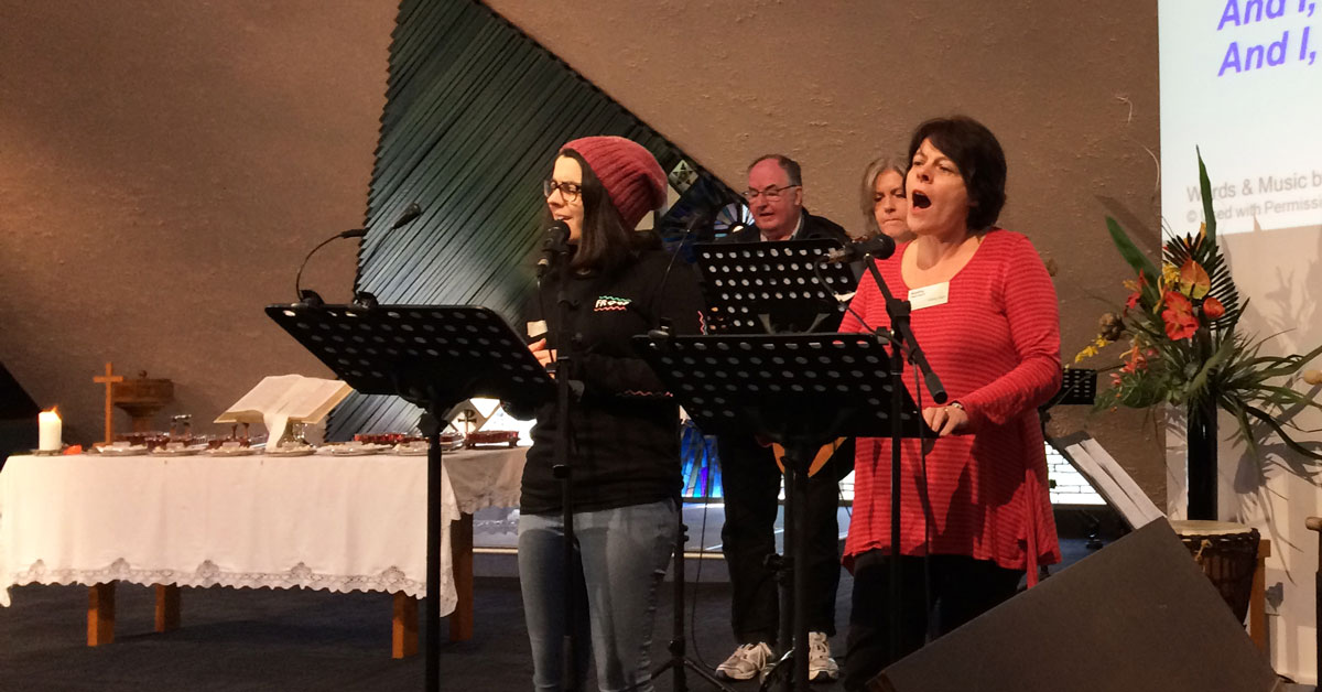 Anna Harrison (left) leading worship at Living Faith Church in Greensborough