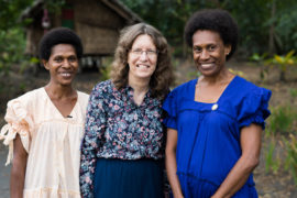 Dr Deidre Palmer with women leaders Martha and Annie at the Vanuatu National Assembly