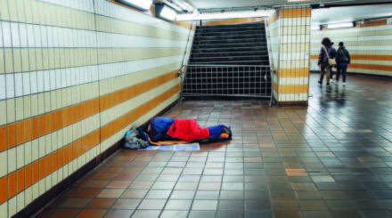 Homeless Man Sleeping in the Underground